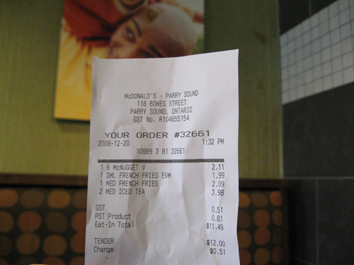 Our McDonald's bill showing our screwed up order.  Check out the pickle on the picture in the background (not our doing).