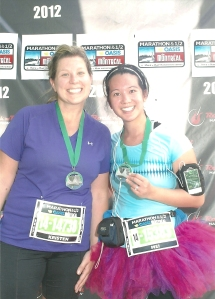 We did it! Kristen and I with our medals.