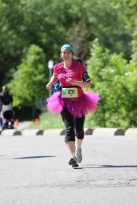 Mei running in a tutu at the Toronto Women's Half Marathon.