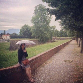Mei sitting on the walls of Lucca.