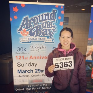Mei at packet pick up with her race bib number