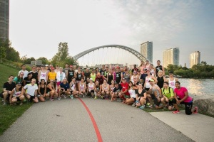 Runners at the site of the landmark that is featured on this year's medal. What an awesome way to reveal it! Photo courtesy of Canada Running Series.