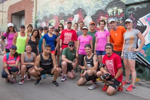 Digital Champions and Community Leaders stop for a picture in Graffiti Alley during the tweet up. Photo courtesy of Canada Running Series.