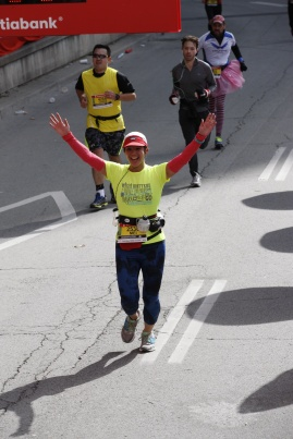 Mei raising her arms and finishing the marathon.