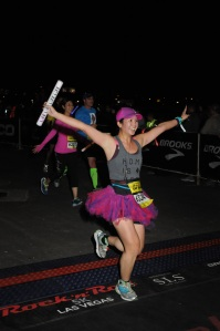 Mei crossing the finish line of the 5k.