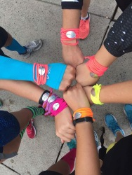 Everybody shows off their JP's Team bracelets.