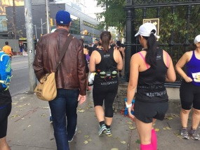 Dan, Rebecca and Mei walking. Mei and Rebecca have #JustShowUp at the bottom of their shirts.